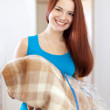 Happy woman with new plaid — Stockfoto