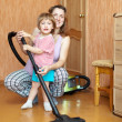 Family chores with vacuum cleaner — Stock Photo #23477967