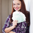 Stock Photo: Happy housewife with many euro