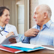 Stock Photo: Senior mcomplaining to friendly doctor