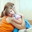 Woman soothes crying child — Stock Photo