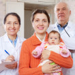 Doctors and mother with three months baby — Foto de Stock