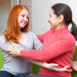 Mother and teenager daughter hugging each other — Stock Photo