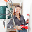 Woman paints wall with roller  — Foto Stock