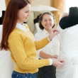 Happy mother with daughter chooses bridal gown — Stock Photo #23478369
