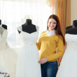 Stock Photo: Woman chooses wedding dress