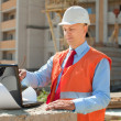 Worker works at building site - Stock Photo