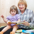 Grandmother and child reading  book — Stock Photo