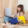 woman and child with laptops — Stock Photo