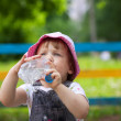 Child drinks from bottle — Stock Photo