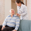 Stock Photo: Doctor talks with senior patient