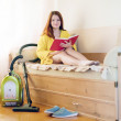 Woman reposes from household chores — Foto de stock #23478957