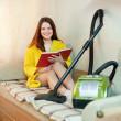 Stock Photo: Young woman rests from household chores