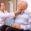 Mature doctor examining senior patient — Stock Photo #23478983