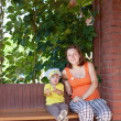 Stock Photo: Mother and child in veranda