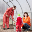 Family sows seeds in soil — Stock Photo #23479067