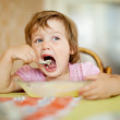 Stock Photo: Child eats with spoon in home