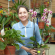 Happy mature woman with Phalaenopsis — Stock Photo