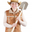 Stock Photo: Happy pastoral womwith spade