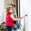 Royalty-Free Stock Photo: Child  with father paints wall