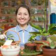 Woman in store for gardeners — Stock Photo