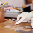 restorer cleaning ancient icon  — Photo