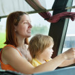 Stock Photo: Mother and child in commercial bus