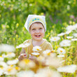 Stock Photo: Baby girl in daisy meadow