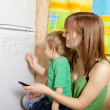 Mother teaches child — Stock Photo #23479729
