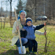 Woman and boy planting  tree - Foto Stock
