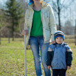 Woman with her son  with spade outdoor - Foto Stock