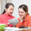 Stock Photo: Daughter and mother counts the family budget