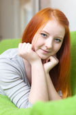 Young girl relaxing on couch — Stock Photo