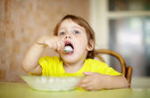 2 years child himself eats dairy — Stock Photo