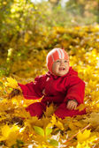 Happy baby in autumn park — Stock Photo