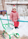 Child with sled in winter park — Stock Photo