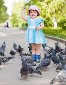 Happy two-year girl playing with doves — Foto de Stock