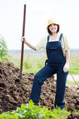 Female farmer works with manure — Stock Photo