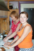 Two women makes pie — Stock Photo