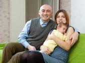 Family of three with newborn baby — Stock Photo