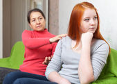 Mother asks for forgiveness from teen daughter — Stock Photo