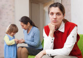 Sad mother against grandmother — Stock Photo