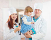 Friendly doctors with child — Stock Photo