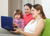 Family of three generations with laptop — Stock Photo