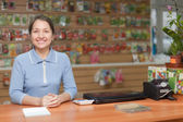 Saleswoman at garden store — Stock Photo