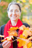 Portrait of mature woman in autumn — Stock Photo
