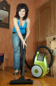 Woman cleaning with vacuum cleaner — Stock Photo