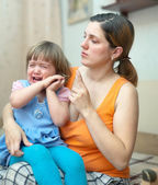 Woman scolds crying child in home — Stock Photo