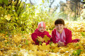 Mother and baby laying on maple leaves — Stock Photo
