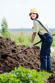 Woman works with animal manure — Stock Photo